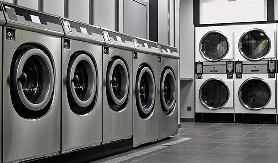 Multi-Unit Dryer Vent Cleaning in Mobile AL, row of machines at a laundromat